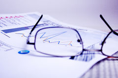 Business documents. Different business documents, viewed trough some glasses Stock Images
