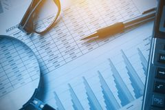 Business documents accounting with calculator, pen, glasses and. Magnifying glass. concept for financial royalty free stock photos