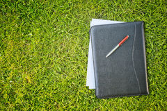 Business Documents on Green Grass Royalty Free Stock Images