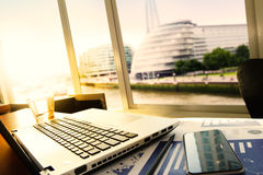 Business documents on office table with smart phone and digital Stock Images