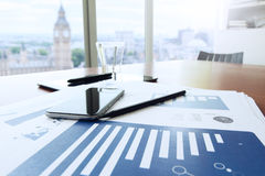Business documents on office table with smart phone and digital Stock Photography