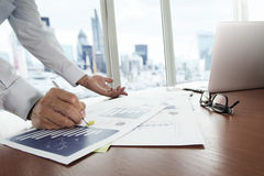 Business documents on office table with smart phone Royalty Free Stock Images