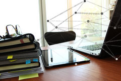 Business documents on office table with smart phone and eye glas. S and modern pen with laptop computer in workspace concept Royalty Free Stock Images