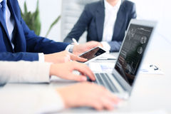 Business documents on office table with smart phone and laptop computer Stock Images