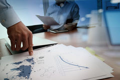Business documents on office table with smart phone Stock Images