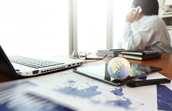 Business documents on office table with texture the world Stock Image