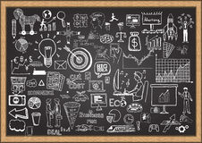 Business doodles on chalkboard Stock Photo
