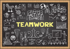 Business doodles on chalkboard with the concept of teamwork. Business doodles on chalkboard with the concept of teamwork Royalty Free Stock Photo