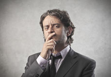 Business Doubting. A businessman is doubting something Royalty Free Stock Photo