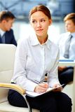 Business dreamer. Pretty business women with dreamy look making notes white at office Royalty Free Stock Image