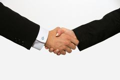 Business dressed male and female shaking hands Stock Images