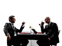 Business drinking wine dinner silhouettes Stock Photo