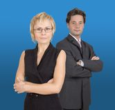 Business duet. Businessman and businesswoman standing Stock Photography