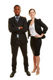 Business duo with two businesspeople. Business duo with men and women as two businesspeople isolated on white background Stock Photography
