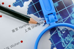 Business in Eastern China. Pencil and magnifier on map, shown as Business or industry developing plan, such as marketing, production, sales quanitity, or related Stock Images