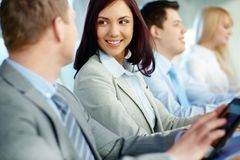 Business education. Young and positive business people attending training Stock Image