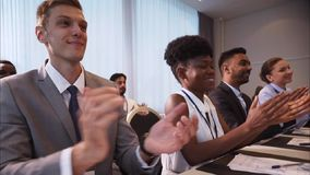 People applauding at business conference stock video