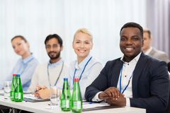 Happy business team at international conference Stock Photography