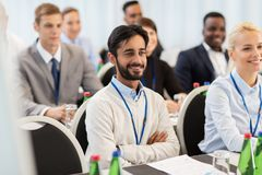 Happy business team at international conference Royalty Free Stock Images