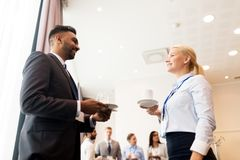 Happy business team at international conference. Business and education concept - group of people at international conference coffee break Stock Image