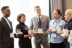 Happy business team at international conference Royalty Free Stock Photo