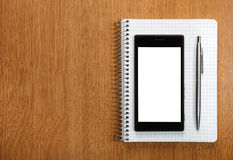 Business and education concept - smartphone and notepad Stock Photos