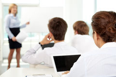 Business education. Business people sitting at seminar Royalty Free Stock Photography