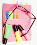 Business, education and technology concept - close up of notebook, paper stickers, pencil different stuff on white Stock Image