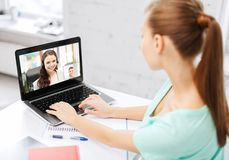 Woman or student having video call on laptop stock image