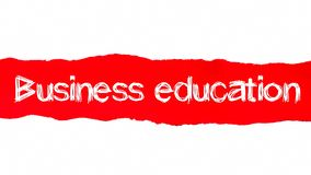 Business education word concept. Business education text appearing behind red torn paper.  stock photography