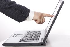 Business elite`s finger touch computer screen.  Stock Photo