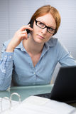 Business Employee on the Phone Royalty Free Stock Images