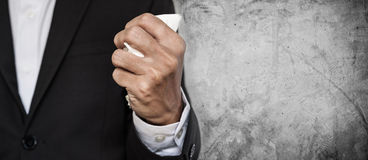 Business employee squeeze crumpled paper in hand, on concrete texture background with copy space Royalty Free Stock Photos