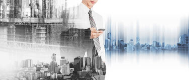 Business employee using smart phone with double exposure city in sunrise and site construction with workers, and panoramic city Stock Images