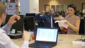 Office bullying and mobbing behavior. Business employees attacking with paper balls their colleague, office scene, aggressive behavior from colleagues, mobbing stock footage