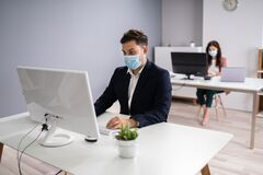 Free Business Employees In Office Wearing Medical Masks Stock Photos - 189289293