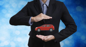 Business employees protecting  car insurance Stock Image
