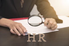 Business employer holding magnifying glass searching. concept HR. And interview, hiring royalty free stock images