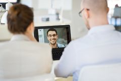 Business team having video conference at office royalty free stock photo