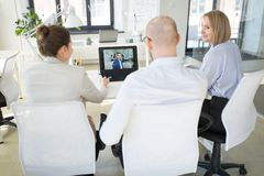 Business team having video conference at office royalty free stock photos