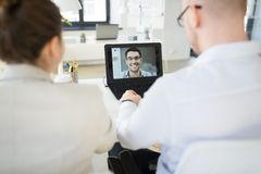 Business team having video conference at office royalty free stock images