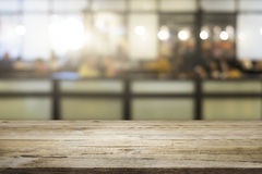 Business empty wooden table for present product on coffee shop. royalty free stock photos
