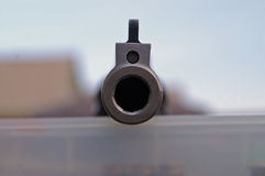 Business end. Camera shot straight down the barrel of large 44 pistol royalty free stock photography