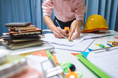 Business engineer contractor working at his desk table in office Stock Photos