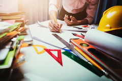 Business engineer contractor working at his desk table in office Royalty Free Stock Photography