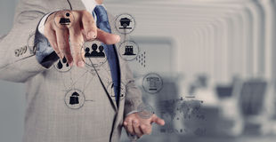 Business engineer hand works industry diagram. On virtual computer as industry concept Stock Image