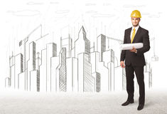 Business Engineer man with building city drawing in background Royalty Free Stock Photography