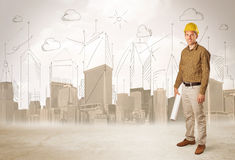 Business engineer planing at construction site with city backgro Stock Photos