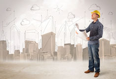 Business engineer planing at construction site with city backgro Royalty Free Stock Photography