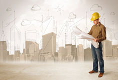 Business engineer planing at construction site with city background stock photo